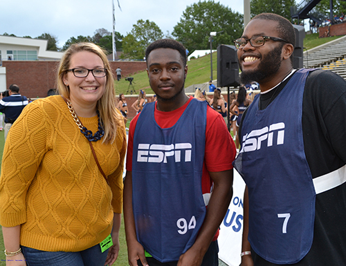 Students working with ESPN at football game