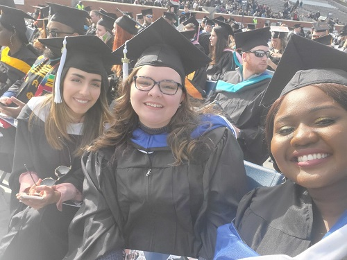 This image has an empty alt attribute; its file name is PCL-grads.jpg