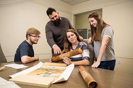 Students examining historical artifact