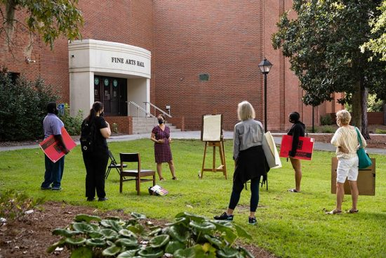 students learning how to sketch outside of Fine Arts Hall on the armstrong campus
